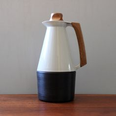 "This wonderful mid century modern Husqvarna ""Signatur"" thermos was designed by Swedish icon Carl-Arne Breger in 1962.    From decopedia:"" Carl-Arne Breger is a Swedish designer mostly known for his designworks in plastics. After graduating from Konstfack in Stockholm in 1948 he was employed by Gustavsberg where - under the supervision of Stig Lindberg - he designed a range of functional day-to-day products in plastics. In 1959 he started his own design studio, Breger Design, wh..."