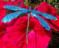 Dragonfly made from twigs, glitter, and maple tree seed (those twirly, helicopter seeds)