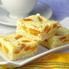 Apricot Coconut Cookie Bars - a shortbread bottom holds up a delicious coconut and apricot topping enriched by sweetened condensed milk. A 35 year old family recipe, these outstanding cookie bars are an apricot and coconut lovers dream. Rock Recipes, Sweet Recipes, Bar Recipes, Newfoundland Recipes, Cookie Recipes, Dessert Recipes, Coconut Cookies, Coconut Bars, Coconut Cream