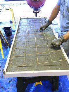 The concrete countertop post is here! This is a doozie so let's just dive right in... first we built our forms... And then we learned how not to do the countertops correctly.... But we weren't about to give up hope. Like the little blue hippo watering can in the picture below....you just gotta...