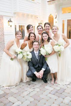 wedding ideas; bridesmaid surrounding the groom
