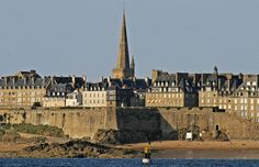 St. Malo, France.  We were there on a beautiful Sunday morning and walked around the wall of the city with the church bells ringing.  The experience was amazing!