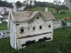 Beautiful antique birdhouse / love the trim around the windows and doors.