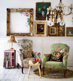 Mix matched floral chairs with curtain covered side table shelf from old nightstand. Use frames in back to frame antique clothes