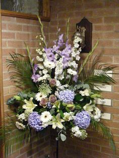 Church flowers in lilac and cream