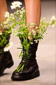 white Flowers in   boots are nice...                                                                                                                                                                                 More