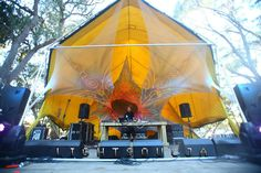 Ex rental stretch tent used as a cover for a geodesic dome