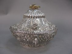 Nadeau's Auctions - Silver jewel box with key and bird finial Realized Price: $2,300.00