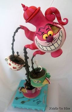 This is a smart cake - Cheshire Cat is pouring the tea, but, at the same time, he is the teapot. Very clever.
