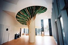 the monumental interior element is made of plywood boards, with leaves composed of suspended, cut paper sheets.
