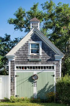 Pretty paint color combo for a coastal carriage house style garage door.