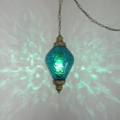 LG MID CENTURY TEAL BLUE OPTIC GLASS HANGING SWAG LAMP LIGHT. $125.00, via Etsy.