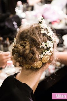 Braids, flowers, and gold coins at Dolce & Gabbana