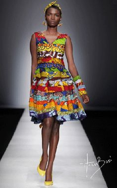 different african prints layered into a dress! colors all over