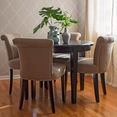 Complement a dining table with coordinating chairs, wallpaper, and a pendant light.
