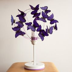 Table lamp made of color aluminium wire, metal white base and paper butterflies…