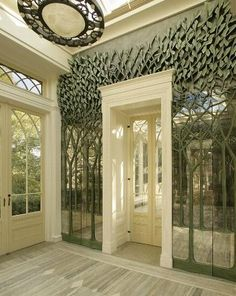 A truly copy of a florest in your living room. Love the leaves on top of the wall screen