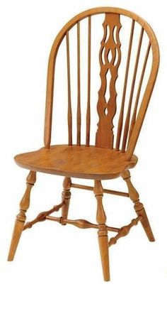 Concord Windsor Dining Chair by Keystone Collection With classic Windsor appeal, the Concord wears steam bent bow, fiddleback, turned legs and scooped seat in the wood and stain of your choice. Handcrafted wood chairs made in Amish country. #diningchair #Windsorchairs