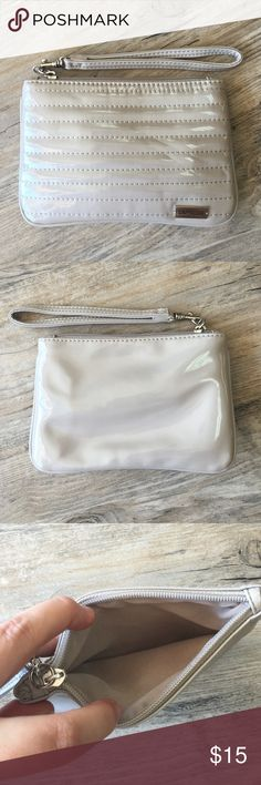 EXPRESS Mini Clutch Nearly brand new mini clutch.  Beautifully beige and perfect on its own or as an additional bag to carry inside your larger tote. Express Bags
