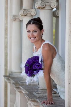 Gina with her gorgeous bouquet of purple lisianthus and white feathers