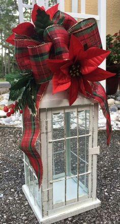lantern with plaid ribbon and poinsettias