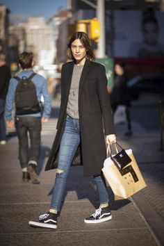 The Best Spring Coat and Jeans Outfits to Wear Now: Black Trench Coat and Distressed Jeans