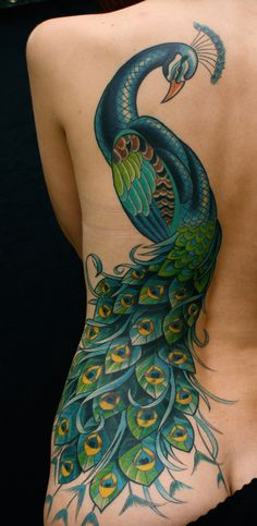 Beautiful peacock back tattoo by Mark Heggie...I want this on my right arm!