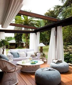 Pergola patios are a popular trend because they provide some shade and are easy to hang objects like curtains and lights from. This outdoor room gives you the homey feeling of your living room with a backyard breeze. Outdoor Rooms, Outdoor Dining, Outdoor Gardens, Outdoor Decor, Outdoor Curtains, Outdoor Furniture, Sheer Curtains, Outdoor Pergola, Outdoor Seating