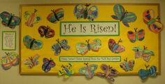 bulletin board for Easter...watercolor and crayon butterflies