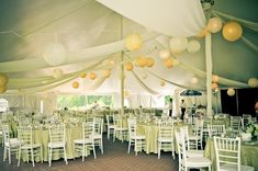 A gorgeous tented reception with paper lanterns! {Miles Witt Boyer Photography}