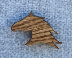 Horse head magnet hand cut on a scroll saw from 1/4 red oak. The wood shapes are then sanded smooth. They are then finished with tinted danish oil to seal in their beauty. Finally, small neodymium rare earth magnets are inset into the back. These magnets are super strong and will easily hold any paper or photo to your refrigerator.  The horse head measures approximately 3 by 3  Due to the nature of wood grain and the hand finish each magnet is slightly different. You may not receive the…