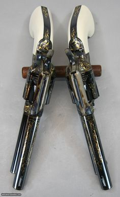 COLT-SAA-Revolvers-Gold-Inlayed-and-Engraved-w-Ivory-Grips-Consecutive-Pair_100847929_75493_9D899D969D6923E9.JPG (1416×2333)