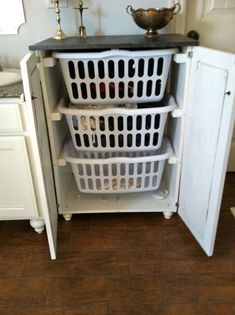 "Bathroom cupboards! Organize and ""hide"" the dirty laundry."