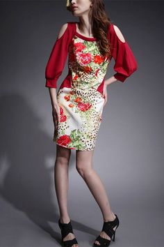 This dress crafted in silk and cotton, featuring round neckline, floral print to front, exposed shoulder detailing, medium sleeves, in medium length cut.$107
