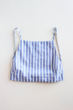 Cropped bustier with thin straps in a soft linen stripe. Semi-fitted through the waist with french darts and an elasticated band at the back. Self lined. Linen stripe, 55% linen, 45% cotton Blue & cre