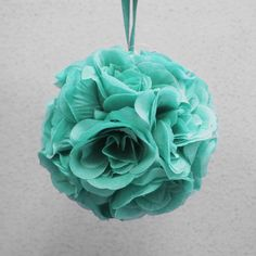 Beautiful artificial flower ball pomanders for an inexpensive kissing ball. There is a satin and/or metallic ribbon for holding.Can be used on their own or comb