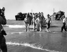 Douglas MacArthur (C), Gen. Richard Sutherland (L) and Col. Lloyd Lehrbas wading ashore during American landing at Lingayen Gulf. This image appeared in the Feb. 1945 photo essay: U. Wins Heart of the Phillippines. Douglas Macarthur, Margaret Bourke White, Uk Visa, Leyte, Iconic Photos, Ww2 Photos, Famous Photos, Prisoners Of War, Photo Essay