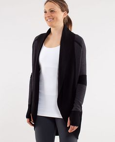 Transformational Sweater from Lululemon. I own this in gray. It's reversible and has a cinch to change length. Like all things Lulu I wear it too much. :)