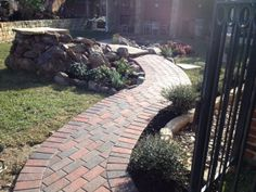 Curved Paver Pathway installed in backyard a large slab is used as a bridge over the pond by the waterfall. Paver Sidewalk, Paver Pathway, Flower Bed Edging, Paving Ideas, Landscape Services, Landscaping Company, Outdoor Living Areas, Pathways, Landscape Design