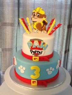Paw patrol cake-I like the idea of trimming the cake in a dog collar...