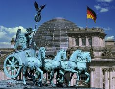 The Brandenburg Gate is one of Berlin's best-known monuments. The Quadriga, a statue consisting of the goddess of peace, driving a four-horse triumphal...