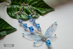 Fairy necklace pendant jewelry. Blue glitter by RoseOfTheFlames
