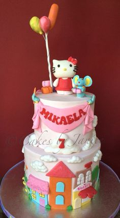 Hello kitty themed bday cake. Inspired by hello kitty fun town. Hello kitty and friend mousie was handmade from fondant and modeling chocolate. Accents around cake are modeling chocolate