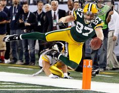 Nice picture taken with a great pose. Shows how good the packers are with a camera
