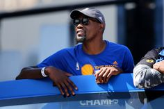 Golden State Warriors' Kevin Durant acknowledges fans from a double decker bus along the route during the Golden State Warriors NBA championship victory parade and rally in Oakland, Calif., on Thursday, June 15, 2017. (Ray Chavez/Bay Area News Group)
