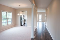 The dining room and entryway of the Preston floor plan by Ball Homes.