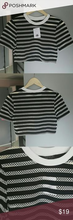 Topshop black and white stripes mesh crop top Super cool and sporty mesh crop top.  Pair with shorts, high waisted jeans or a skater skirt! Topshop Tops Crop Tops