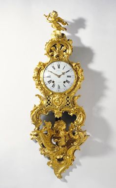 Clock on Bracket (Cartel sur une console), about 1758, clock movement by Jean Romilly (French, 1714 - 1796, master 1752), case attributed to Charles Cressent (French, 1685 - 1768, master 1719), bracket by Jean-Joseph de Saint-Germain (French, 1719 - 1791, master 1748). Gilt bronze, enameled metal; glass