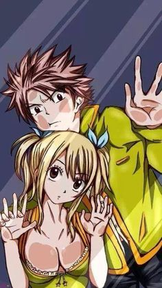 Lucy and Natsu from Fairy Tail. Anime behind glass.