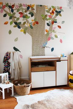 leaves. add some pretty little frames hanging from ribbon and it's a family tree.